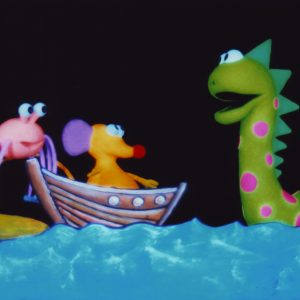three animated puppets stand on an animated shore. On the left a small spider, a mouse on a boat, and the Loch Ness Monster to the right.